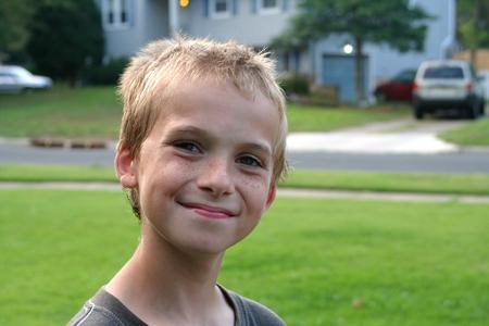 Happy Boy In Residential Neighborhood photo