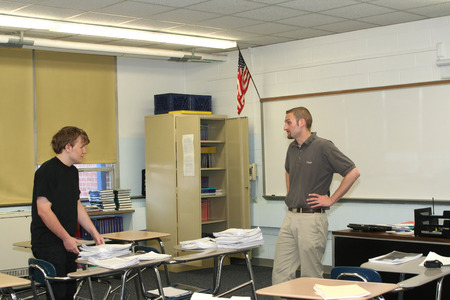 Teacher And Student Discussing Schoolwork photo