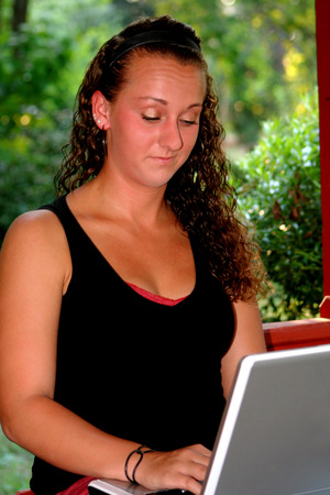 Dubious Teen Girl Looking at Laptop