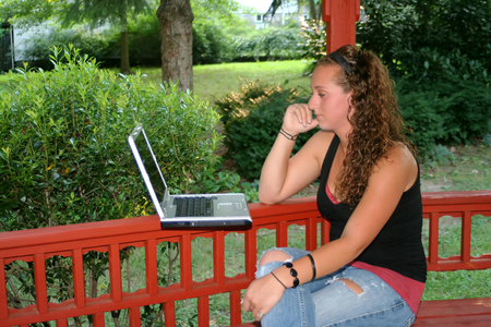 Teen Girl Studying Laptop Outdoors