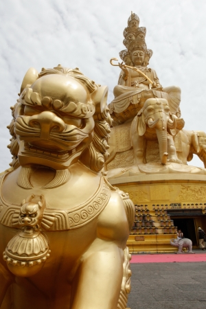 Golden Buddha statue on Mount Emei summit in china Stock Photo - 15156269