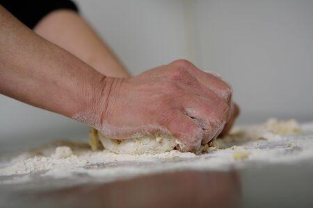 senior woman preparing at home handmade pasta photo