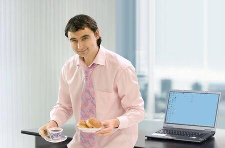 coffe break: businessman near own work place that has a coffe break