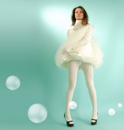 roseleaf: snow-white girl like light snowflake or cloud with bubbles Stock Photo