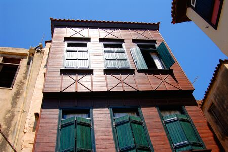 wooden color house and old windows with shutters photo
