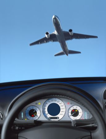 honk: Wheel and dashboard of a car and view through the windshield on the aircraft Stock Photo