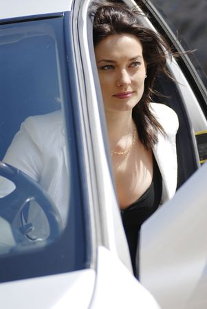 lean out: Businesswoman rolled down from the premium car
