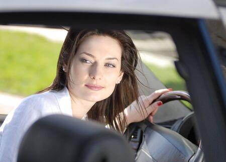 portrait of beautiful woman in the premium car Stock Photo