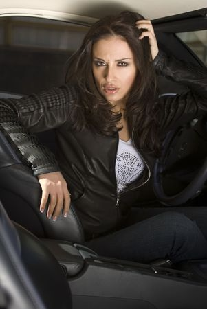 European businesswoman siting in the expensive car photo