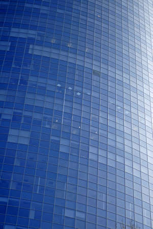 Modern sky-scraper close-up toned in blue color Stock Photo - 4737569