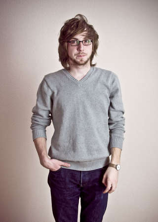portrait young handsome man in glasses standing near the wall Stock Photo - 4807542