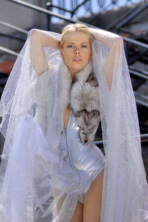 fiancee: beautiful young fiancee on white dress with blue fox Stock Photo