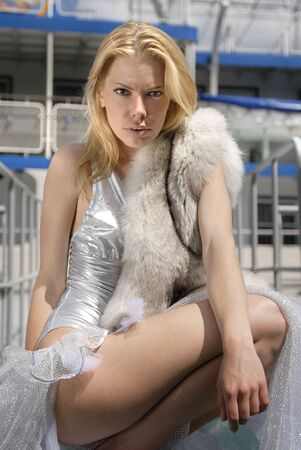 silver fox: beautiful blond woman with blue fox on a deck of ship