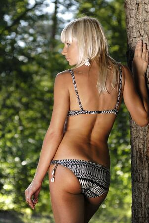 blonde underwear: beautiful back of woman in underclothes in the forest Stock Photo