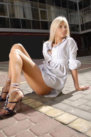 beautiful blond girl in chemise on floor of shopping mall photo