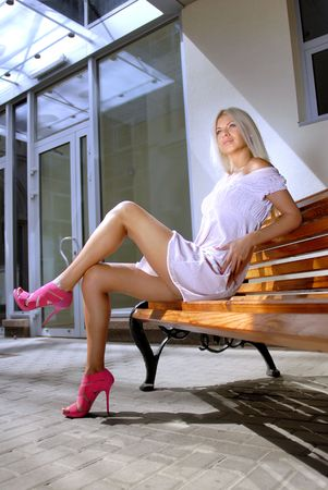 svelte: Beautiful blonde woman on a bench is waiting job interview