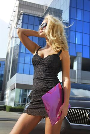 Portrait of a blonde pretty business woman looking away Stock Photo - 5627017
