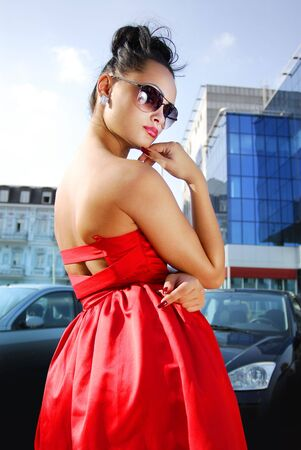 beautiful independent brunette in sunglasses and red dress Stock Photo - 5627021