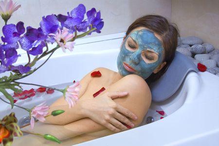 beautiful woman in the bath of spa salon photo