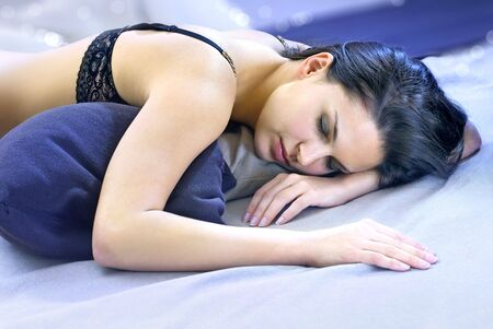 morn: beautiful brunette woman felt asleep into delicious dreams Stock Photo