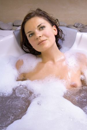 bare body women: beautiful woman in the bath of spa salon Stock Photo