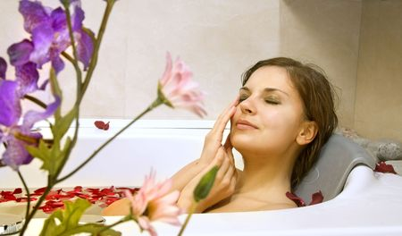 beatitude: beautiful woman in a bath with petals of rose