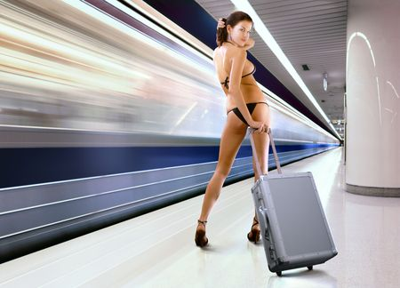 subway platform: beautiful woman in underwear with luggage in subway