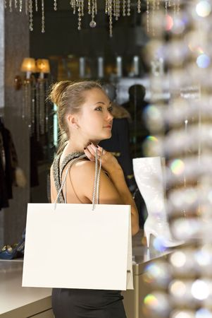 beautiful buyer with fawny bag in the boutique photo