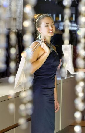 beautiful buyer with fawny bag in the boutique Stock Photo - 5753899