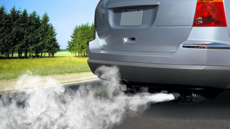 spare car: pollution of environment by combustible gas of a car Stock Photo