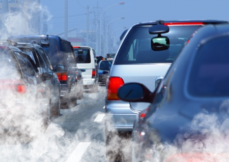air traffic: pollution of environment by combustible gas of a car Stock Photo