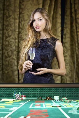 croupier: beautiful woman in a casino gambling on the roulette