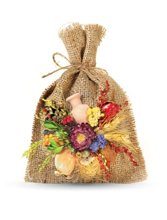Ukrainian souvenir like cheesecloth bag that made of dried materials and plants photo