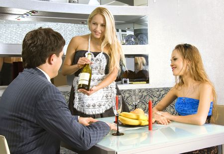 courting couple and blonde waitress in a restaurant Stock Photo - 6026709