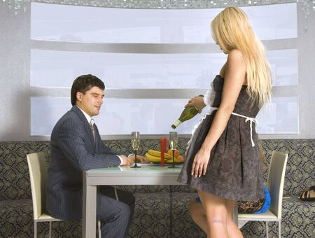 courting couple and blonde waitress in a restaurant photo
