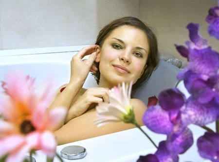 beatitude: beautiful woman in a bath with petals of flowers Stock Photo