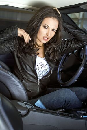 scandalous: american expressional woman siting in the expensive car
