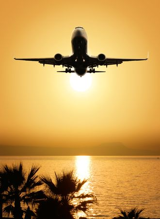 beautiful sea view and plane on sunset background photo