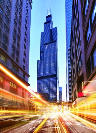 willis: Willis Tower and modern city at night with freeway traffic