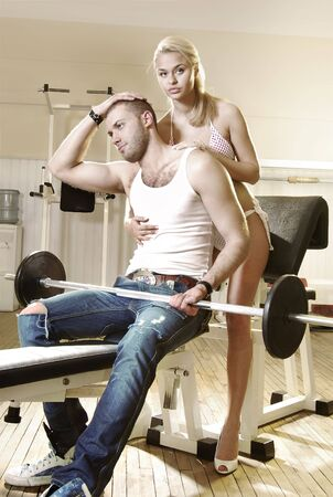 volition: courting couple in exercise room, man and woman have tender love story Stock Photo