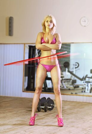 superwoman: hermosa rubia sexy en axercise sala, rotaci�n del aro