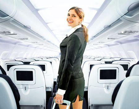 air crew: beautiful flight attendant on board of big plane Stock Photo