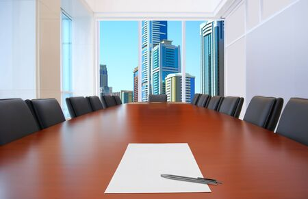 conference room meeting: meeting room, in front focus placed sheet of paper and pen on table Stock Photo
