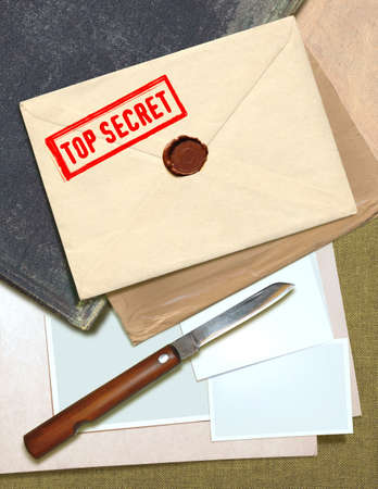 military top secret envelope with stamp and knife for papers photo