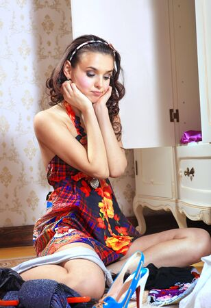 beautiful young woman don't know what to wear