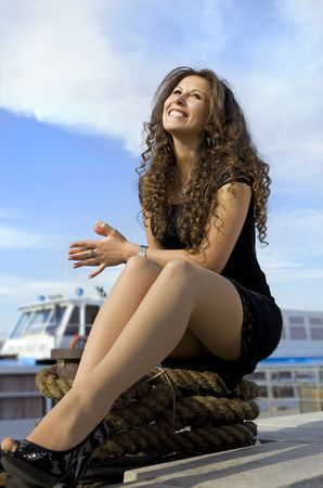 beautiful cheerful girl has a rest on landing stage Stock Photo - 7135101