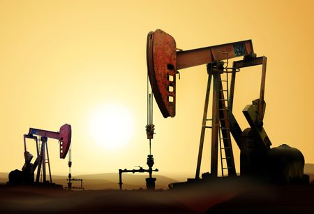 derrick: Working oil pump in deserted district at sunset Stock Photo