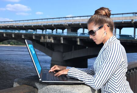 business woman with the laptop on city quay Stock Photo - 7205331