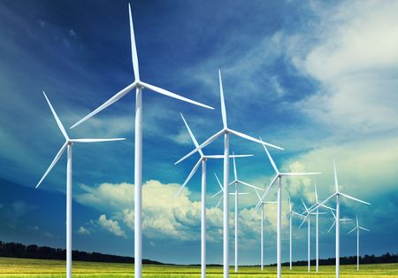 conservation: Beautiful green meadow with Wind turbines generating electricity Stock Photo