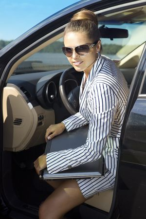 avocation: beautiful businesswoman with laptop computer in black car